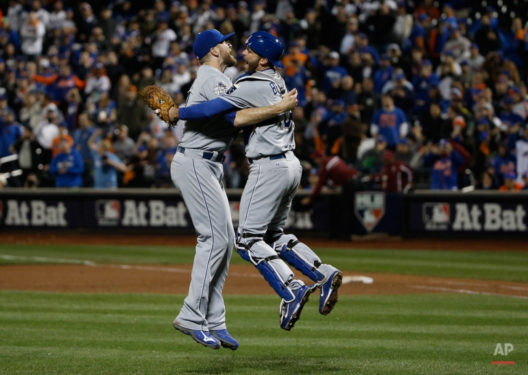 Kansas City Royals pitcher Wade Davis (17) celebrates with Drew Buteraafter Game 5 of the Major League Baseball World Series against the New York Mets Monday, Nov. 2, 2015, in New York. The Royals won 7-2 to win the series. (AP Photo/Matt Slocum)