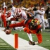 Maryland wide receiver D.J. Moore, right, scores a touchdown in front of Wisconsin cornerback Derrick Tindal in the first half of an NCAA college football game, Saturday, Nov. 7, 2015, in College Park, Md. (AP Photo/Patrick Semansky)