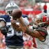 Dallas Cowboys cornerback Brandon Carr (39) knocks a pass away from Tampa Bay Buccaneers wide receiver Mike Evans (13) during the second quarter of an NFL football game Sunday, Nov. 15, 2015, in Tampa, Fla. (AP Photo/Brian Blanco)
