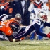 New England Patriots wide receiver Chris Harper (14) fumbles on a punt return as Denver Broncos wide receiver Cody Latimer (14) defends during the second half of an NFL football game, Sunday, Nov. 29, 2015, in Denver. The Broncos recovered the ball. (AP Photo/Jack Dempsey)