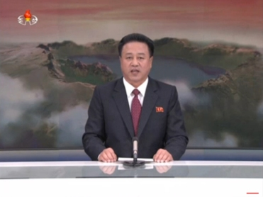 In this image made from video from KRT, North Korean state broadcaster, a North Korean man speaks during a broadcast aired on Wednesday, Jan. 6, 2016. North Korea says it has conducted a hydrogen bomb test. The surprise announcement that complicates already difficult efforts to curb the country's push for a working nuclear arsenal. (KRT via AP Video)