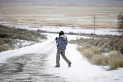 """A members of the group occupying the Malheur National Wildlife Refuge headquarters, stands guard Monday, Jan. 4, 2016, near Burns, Ore. The group calls itself Citizens for Constitutional Freedom and has sent a """"demand for redress"""" to local, state and federal officials. Armed protesters took over the Malheur National Wildlife Refuge on Saturday after participating in a peaceful rally over the prison sentences of local ranchers Dwight and Steven Hammond. (AP Photo/Rick Bowmer)"""