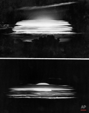 The skyline, top, at Bikini Atoll in the Pacific is a study in black and white with the airplane-dropped H-bomb silhouettes clouds on Monday, May 21, 1956 (Bikini Atoll time). Below, in another picture taken about 50 miles from the target, the cloud forms the shape of a man-made sun. (AP Photo)