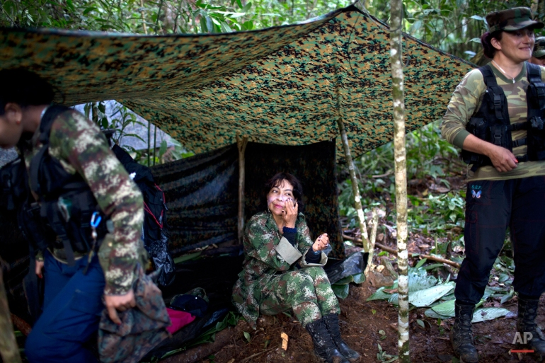 In this Jan. 4, 2016 photo, Yira Castro, a mid-level commander for the 36th Front of the Revolutionary Armed Forces of Colombia, or FARC, rubs moisturizing creme on her face, in a hidden camp in Antioquia state, in the northwest Andes of Colombia. Castro is a sort-of den mother to other female rebels who in the FARC have found a sense of empowerment they say is lacking in macho Colombian society. (AP Photo/Rodrigo Abd)