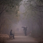 In this Wednesday, Dec. 23, 2015, file photo, people exercise at a park on a foggy morning in New Delhi, India. (AP Photo/Saurabh Das)
