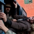 Supporters of All Parties Hurriyat Conference(APHC) shout pro-freedom slogans as Indian policemen detain them during a protest in Srinagar, Indian controlled Kashmir, Wednesday, Dec. 30, 2015. The protest was held against an alleged killing of a woman and her four year old son by a member of the Village Defense Committee (VDC), a body of civilian volunteers armed by the Indian government to fight insurgents. (AP Photo/Dar Yasin)