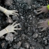 Indian women use bare hands to pick reusable pieces from heaps of used coal discarded by a carbon factory in Gauhati, India, Monday, Dec. 14, 2015. The collected pieces will be reused for cooking food. (AP Photo/Anupam Nath)