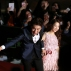 South Korean actor Lee Kwang-soo, left, and actress Park Bo-young shake hands with their fans on the red carpet of the 2015 Mnet Asian Music Awards (MAMA) in Hong Kong, Wednesday, Dec. 2, 2015. (AP Photo/Kin Cheung)