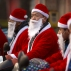 Food delivery drivers dressed in Santa Claus suits line up before the start of their work day in Beijing, Wednesday, Dec. 23, 2015. Although not an official holiday in China, Christmas is marked as a shopping and commercial event in China's capital. (AP Photo/Mark Schiefelbein)