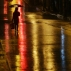 A woman walks during rainfall caused by Typhoon Melor in Quezon city, north of Manila, Philippines on Tuesday, Dec. 15, 2015. Typhoon Melor weakened Tuesday as it crossed over the central Philippines, leaving one man dead and wide areas without power. (AP Photo/Aaron Favila)