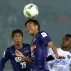 Sanfrecce Hiroshima's Yoshifumi Kashiwa, center, heads the ball away from Auckland City FC's Alfred Rogers, right, of England during their match at the FIFA Club World Cup soccer tournament in Yokohama, near Tokyo, Thursday, Dec. 10, 2015. (AP Photo/Eugene Hoshiko)