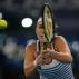 Belinda Bencic of Singapore Slammers returns a shot to Ajla Tomljanovic of Philippines Mavericks in the women's singles event at the International Premier Tennis League in New Delhi, India, Friday, Dec. 11, 2015. (AP Photo/Tsering Topgyal)