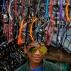 A Bangladeshi roadside vendor wears sunglasses to attract customers to his shop in Dhaka, Bangladesh, Monday, Dec. 28, 2015. (AP Photo/A.M. Ahad)