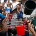 Residents use buckets to fill up the tank of a fire truck during a fire at a residential and commercial area in downtown Quiapo in Manila, Philippines, Friday, Dec. 4, 2015. Fire officials said a number of people were injured in the fire that gutted several homes and business establishments and left close to a thousand families living in the area homeless. (AP Photo/Bullit Marquez)