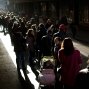 """People line up along a street as they wait to buy lottery tickets in Madrid, Spain, Saturday, Dec. 19, 2015. Spaniards are taking advantage of unusually warm weather and a """"day of reflection"""" break in political campaigning ahead of general elections to buy tickets for the world's richest lottery. Spain's annual Christmas lottery, known as El Gordo or the Fat One, is due to hand out 2.24 billion euros ($2.43 billion) in winnings throughout Spain on Tuesday. (AP Photo/Emilio Morenatti)"""