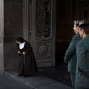 A nun leaves a polling station as Guardia Civil officers stand guard, after casting her vote for the national elections in Madrid, Sunday, Dec. 20, 2015. Spaniards are voting in an historic national election Sunday with the country's traditional two-parties and widely anticipated strong showings for two new parties. (AP Photo/Emilio Morenatti)