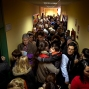 Voters line up to vote in a crowded corridor as others try to leave after casting their ballots at a polling station in Madrid, Sunday, Dec. 20, 2015. Spaniards are voting in an historic national election Sunday with the country's traditional two-parties and widely anticipated strong showings for two new parties. (AP Photo/Emilio Morenatti)