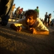 A man crawls as self-imposed penance during a pilgrimage to the shrine of Saint Lazarus, in El Rincon, near Santiago de las Vegas, Cuba, Dec. 16, 2015. Lazarus also is identified as the Yoruba deity Babalu Aye - the protector of the sick who took upon himself all the illnesses of his people to save them. (AP Photo/Ramon Espinosa)