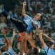 Palmeiras players lift the team's coach Marcelo Oliveira as they celebrate at the end of the Copa do Brasil final soccer match against Santos in Sao Paulo, Dec. 3, 2015. Palmeiras won in a penalty shootout after tying 2-2 on aggregate.(AP Photo/Andre Penner)