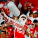 A fan of Colombia's Independiente Santa Fe cheers for his team during a Copa Sudamericana final soccer match against Argentina's Huracan in Bogota, Colombia, Dec. 9, 2015. (AP Photo/Daniel Munoz)