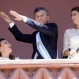 Argentina's new President Mauricio Macri dances before supporters, flanked by his Vice President Gabriela Michetti, left, and wife Juliana Awada, at the government house in Buenos Aires, Argentina, on the day of his inauguration, Dec. 10, 2015. Macri promises to usher in an era of more civil discourse and roll back much of the previous administration's spending that many economists say has brought Argentina to the brink of another financial crisis. (AP Photo/Victor R. Caivano)