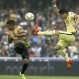 America's Javier Guemez, right, competes for the ball with Pumas' Javier Cortes during a Mexican soccer league semi-final match in Mexico City, Dec. 6, 2015. Pumas advanced to the Torneo de Apertura final on an aggregate score. (AP Photo/Christian Palma)