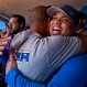 St. Louis Cardinals player Brayan Pena, from Cuba, embraces a former colleague before giving a baseball clinic to children in Havana, Dec. 16, 2015. A group of Cuban-born baseball stars once disdained by the island's government for defecting to the United States taught their craft to some of the island's youngest players on Wednesday as part of a triumphant return to Cuba. (AP Photo/Ramon Espinosa)