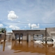 A car and homes are submerged in floodwater in Concordia, Argentina, Dec. 28, 2015. At least 20,000 have been evacuated in Argentina. Neighboring Paraguay has been hardest hit, with 100,000 evacuating. Several thousand have also been evacuated in Uruguay and southern Brazil. (AP Photo/Natacha Pisarenko)