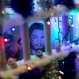 A prisoner looks through the bars of her cell during a Christmas decorating contest at the Nelson Hungria prison in Rio de Janeiro, Dec. 10, 2015. Each cell of 50 women or more also put on a skit dramatizing Biblical stories, with many depictions of Jesus' life, as well as David and Goliath and Daniel in the lions' den, giving prison's would-be thespians their chance to shine. Voices soared in rapture with the religious songs, and many, many tears were shed. (AP Photo/Silvia Izquierdo)