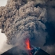The Momotombo volcano spews a large plume of gas and ash as seen from the rural community of Papalonal, in Leon, Nicaragua, Dec. 2, 2015. Quiet for many years, the volcano emitted some glowing rock on Wednesday, after gas and ash emissions began Tuesday. In 1610, the city of Leon was destroyed during an eruption of the Momotombo and was relocated west, where it is currently located. (AP Photo/Esteban Felix)