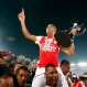 Sergio Otalvaro, of Colombia's Independiente Santa Fe, rides on the shoulders of a teammate as he celebrates with the trophy in his hand, after after winning the Copa Sudamericana final soccer match against Argentina's Huracan in Bogota, Colombia, Dec. 9, 2015. Santa Fe won the match and became champion in a penalty shoot-out. (AP Photo/Daniel Munoz)