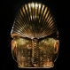 The gold mask of King Tutankhamun is displayed in its glass case, in the Egyptian Museum near Tahrir Square, in Cairo Wednesday, Dec. 16, 2015 . Antiquities Minister Mamdouh el-Damaty says the famed golden burial mask has been fixed, over a year after the beard was accidentally knocked off and hastily glued back with epoxy. A German-Egyptian team began the restoration work in October. (AP Photo/Nariman El-Mofty)
