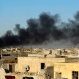 Smoke rises from Islamic State positions following a U.S.-led coalition airstrike as Iraqi Security forces advance their position in downtown Ramadi, 70 miles (115 kilometers) west of Baghdad, Iraq Friday, Dec. 25, 2015. Iraqi forces entered the Huz at dawn, an area housing a government compound in the center of Ramadi, part of a major offensive aimed at dislodging the Islamic State terrorist militia from the western city, an Iraqi official said. (AP Photo/Osama Sami)