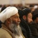 Former militia men attend the inauguration of the Afghanistan Protection and Stability Council in Kabul, Afghanistan, Friday, Dec. 18, 2015. It is the first opposition party to be established since the Taliban were toppled in 2001. (AP Photo/Rahmat Gul)