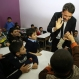 Italian Prime Minister Matteo Renzi, right, greets Syrian children at a Lebanese public school where only Syrian students attend classes in the afternoon, in Bchamoun village, mount Lebanon, Tuesday Dec. 22, 2015. Renzi is in Lebanon to meet with Lebanese officials and to visit the Italian UN peacekeepers who work in south Lebanon and to visit Syrian refugee schools. (AP Photo/Hussein Malla)