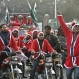 In this Sunday, Dec. 20, 2015 photo, Pakistani Christians wear Santa Claus jackets, during a rally in Lahore, Pakistan. (AP Photo/K.M. Chaudary)