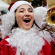 A Lebanese woman wearing a Santa Claus costume sings during a Christmas event, in downtown Beirut, Lebanon, Saturday, Dec. 19, 2015. (AP Photo/Hussein Malla)
