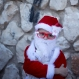 An Israeli Arab Christian boy dressed up as Santa Claus waits for the start of the annual Christmas parade in in the northern Israeli city of Nazareth, Israel, Thursday, Dec. 24, 2015. (AP Photo/Ariel Schalit)