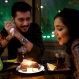 An Iranian woman celebrates her birthday with her friend at a cafe in downtown Tehran, Iran, Tuesday, Dec. 8, 2015. (AP Photo/Ebrahim Noroozi)