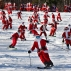 Skiers and snowboarders dressed as Santa take a run en masse at the Sunday River ski resort, Sunday, Dec. 6, 2015, in Newry, Maine. Skiers with full Santa outfits got free lift tickets for donating $15 to the Sunday River Community Fund. (AP Photo/Robert F. Bukaty)