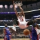 Chicago Bulls center Joakim Noah (13) dunks between Detroit Pistons guard Reggie Jackson (1) and Anthony Tolliver (43) during the first half of an NBA basketball game Friday, Dec. 18, 2015, in Chicago. (AP Photo/Charles Rex Arbogast)