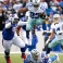 Dallas Cowboys running back Robert Turbin (23) leaps over teammate tight end Jason Witten (82) as Buffalo Bills defensive tackle Stefan Charles (96) chases him during the first half of an NFL football game, Sunday, Dec. 27, 2015, in Orchard Park, N.Y. (AP Photo/Bill Wippert)
