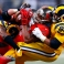 Tampa Bay Buccaneers running back Doug Martin, center, is pulled down by St. Louis Rams defensive tackle Aaron Donald, right, and outside linebacker Mark Barron during the second quarter of an NFL football game Thursday, Dec. 17, 2015, in St. Louis. (AP Photo/Billy Hurst)