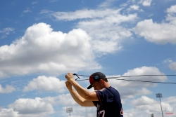 Minnesota Twins pitcher Nick Burdi stretches with an elastic band during a spring training baseball workout in Fort Myers, Fla., Monday, Feb. 29, 2016. (AP Photo/Patrick Semansky)