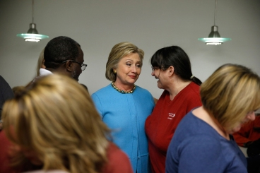 Democratic presidential candidate Hillary Clinton meets with employees at a Velcro Companies facility Monday, Feb. 8, 2016, in Manchester, N.H. (AP Photo/Matt Rourke)