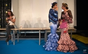 Models are seen backstage during the International Flamenco Fashion Show in Seville, Spain, Friday, Feb. 5, 2016. The fashion event presents dramatic vibrant designs around the traditional Flamenco art. (AP Photo/Miguel Angel Morenatti)