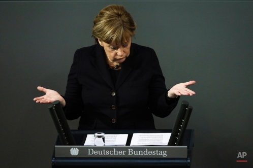 German Chancellor Angela Merkel delivers a speech about refugee policy and Europe a day before an EU council meeting, at the German parliament Bundestag in Berlin, Germany, Wednesday, Feb. 17, 2016. Merkel said it's in Germany's 'national interest' for Britain to remain 'active member' of EU. (AP Photo/Markus Schreiber)