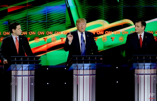 Republican presidential candidate, businessman Donald Trump, center, speaks as Republican presidential candidate, Sen. Marco Rubio, R-Fla., left and Ted Cruz, R-Texas look on during a Republican presidential primary debate at The University of Houston, Thursday, Feb. 25, 2016, in Houston. (AP Photo/David J. Phillip)