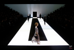 Models wear creations for Giorgio Armani women's Fall-Winter 2016-2017 collection, part of the Milan Fashion Week, unveiled in Milan, Italy, Monday, Feb. 29, 2016. (AP Photo/Antonio Calanni)