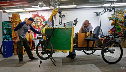 Ryan Ballard, left, founder of the Krewe of Chewbacchus Mardi Gras parade, works on a float with Keith Greene, King of Chewbacchus 2016, at their headquarters at the Castillo Blanco Art Studios in New Orleans, Saturday, Jan. 2, 2016. (AP Photo/Gerald Herbert)